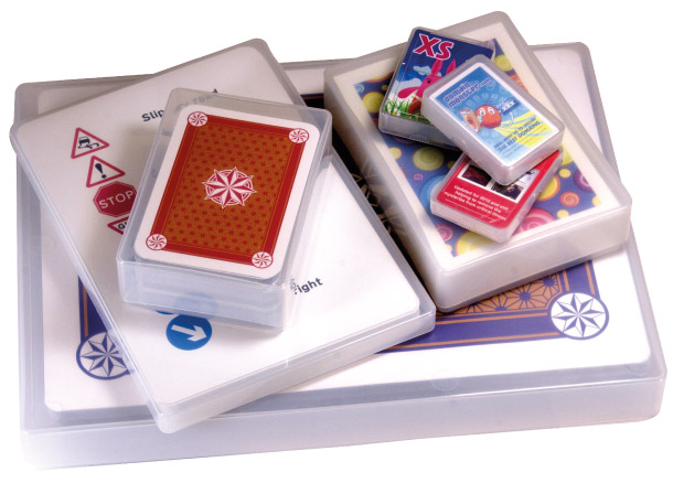 A collection of different size plastic playing card boxes